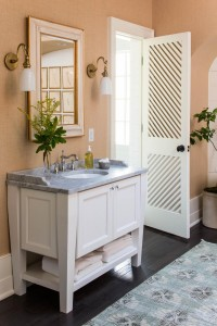His and hers marble vanities and custom made doors add symmetry to the master bath.