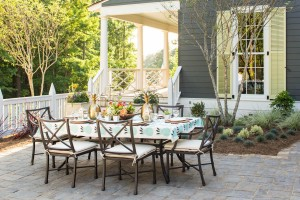 The dining terrace, designed by Margaret Kirkland Interiors, is highlighted by native landscape and hardscape done by David N. Brush, Landscape Architect.