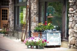 Residents purchase beautiful flowers outside Jimbo's Soda Fountain.