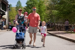 Families leisurely explore the business district during the Mt Laurel Spring Festival.