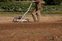 A farmer seeds the land on Mt Laurel's 25-acre organic farm.