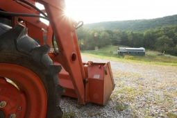 Resting on the hillside, a tractor overlooks the bountiful 25-acre organic farm.
