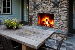 This outdoor patio features a stonework fireplace—perfect for entertaining guests on mild days.