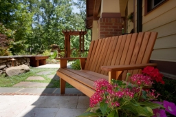 A cedar bench provides the perfect place for residents to hang out in their backyard.
