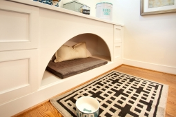 Custom built-in dog bed offers an organized place for the four-legged members of the family.