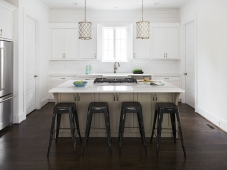 Light and bright kitchen with large island and shiplap walls.   Photo: Tommy Daspit