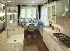 Granite counters, custom white cabinetry, and Kitchenaid appliances make the gourmet kitchen elegant and functional.