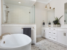 This master bathroom features a freestanding tub, customized cabinetry and beautiful tile. Photo: Tommy Daspit