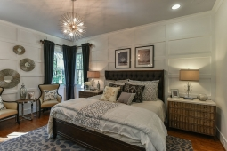 Unique wood trim adds character to the contemporary design in this master bedroom.